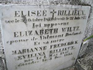 The grave reads: Eliseé Rilliéux, Elizabeth Wiltz, Marianne Frederick, Evilina Rilliéux