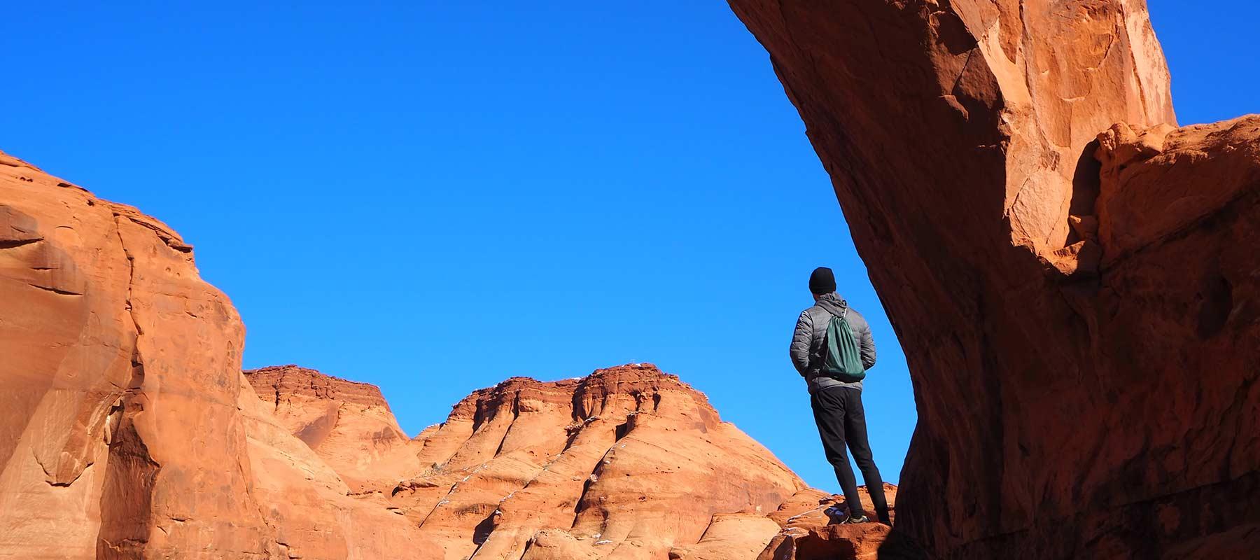 Man standing on red rocks in Utah